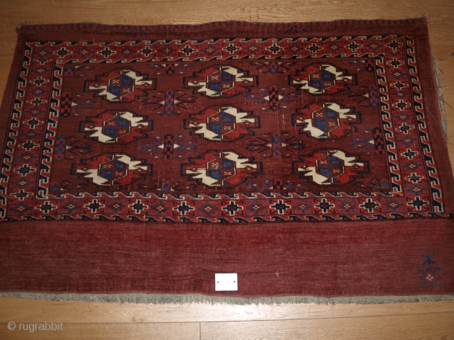 Yomut 9 gul chuval complete with plain weave back. Size: 127 x 81cm.