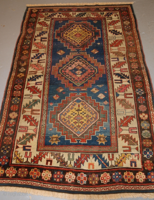 Antique Caucasian 3 medallion Kazak rug with superb colour and great design. www.knightsantiques.co.uk 