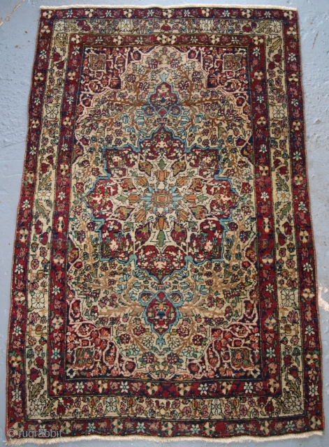 Antique Persian Kirman rug of very small size and good colour. www.knightsantiques.co.uk  