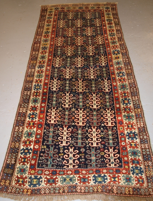 Antique Caucasian long rug with most unusual repeat design. 