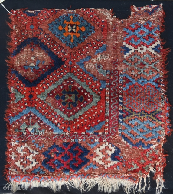 From Sonny Berntssons collection: Antique East (?) Anatolian rug fragment mounted on fabric. All natural colours. 52 x 57 cm plus fabric
