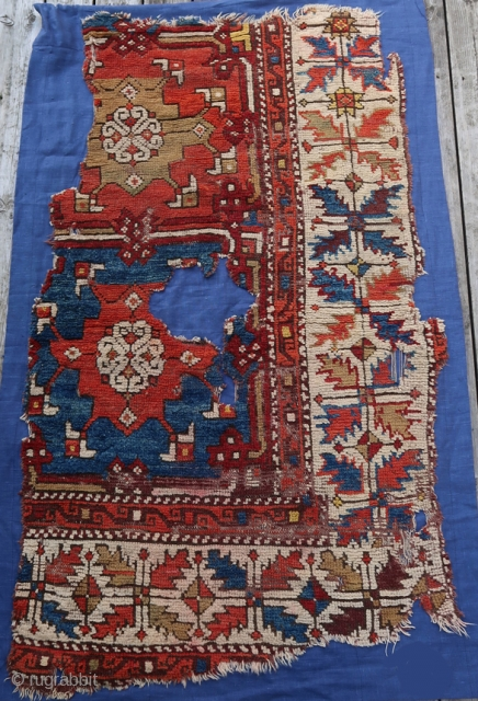 From Sonny Berntssons collection: Antique Anatolian rug fragment mounted on fabric. 73 x 123 cm plus fabric. Fantastic colours. More info or photos if you ask.