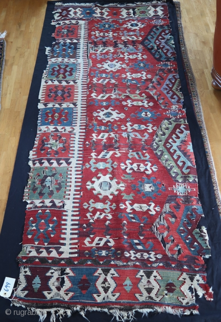From Sonny Berntssons collection: Antique Anatolian kilim, mounted on fabric. All natural colours. 86 x 223 cm plus fabric.