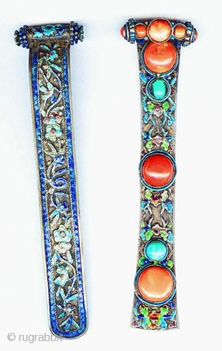 Two hair pins , silver with elaborate enameling, one with large coral. Sold separately. Mongolia, 19th c