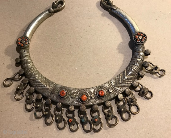 Silver and inlaid coral torque from Pakistan.
