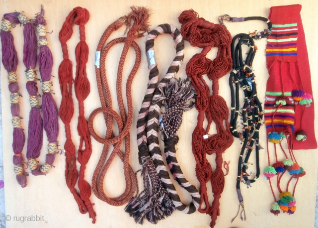 A COLLECTION OF HAND WOVEN CEREMONIAL BERBER TRIBAL BELTS from the Middle and High Atlas mountains. Decorative belts are woven with fine hand spun wools and silk and are sometimes embellished with  ...
