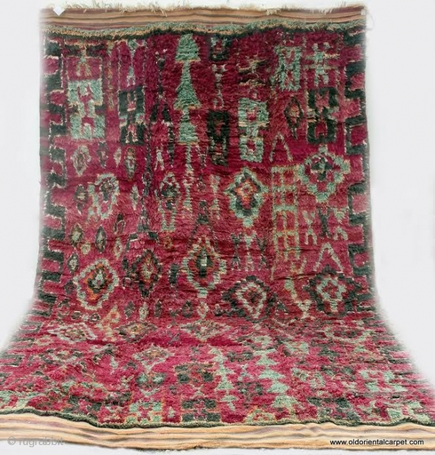 MOROCCAN BERBER HIGH ATLAS CARPET. An old and rare carpet from the Berbers of Ait bou Ichaouen in the eastern High Atlas near the border with Algeria. Weaving in this remote area  ...