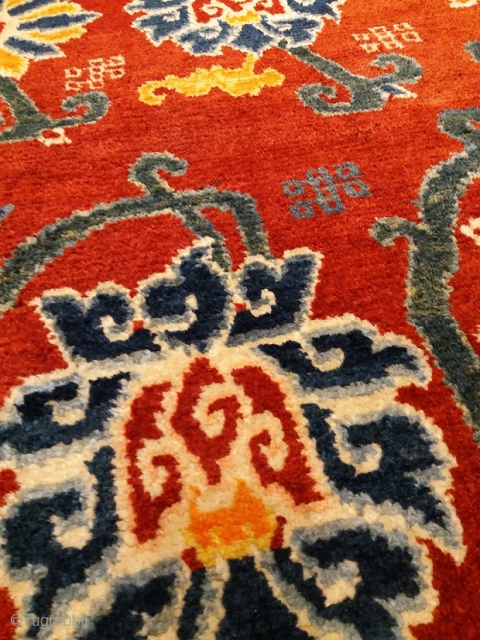 """Antique Tibetan rug for monastic use, khaden size (circa 142 by 70 cm), fantastic red color, elegant lotus flowers and funny """"wrong"""" endless knots, excellent condition, no repairs, very good age, cheap  ..."""