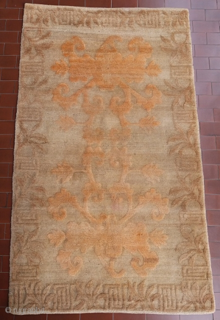 """It recalls a French Aubusson but it is a truly unusual Tibetan khaden rug of the rare """"buma rimo"""" family (i.e. """"cut like a mountain""""), with an uncommon high rilief border and  ..."""