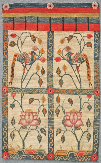 Tibetan door curtain rug. Early 20th Century. Natural and aniline dyes. Rare type of rug and rare design of peacocks in the two top windows and lotus flowers in lower ones.