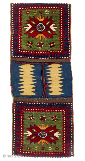 Late 19th Century Southwest Caucasian Complete double bags from the Kazak region are rarely seen in the market. In this example, the two faces show a large star on a green ground,  ...