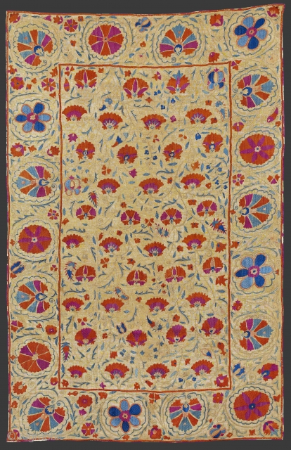 Mid 19th century Central Asia, South West Uzbekistan Bokhara Suzani.A Bokhara suzani in the nim format. The field displays a repeat of delicate golden stems bearing red side-view flowers, slender green leaves  ...