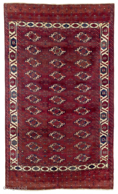First half 19th century Central Asia, West Turkestan Karadashli Main Carpet  The 33 large chuval güls of the red-brown field are spaciously arranged in rows of three and interspersed with delicately drawn chemche  ...