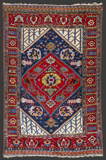 Late 19th century,South West Persia, Fars Khamseh Rug In this Khamseh, probably a weaving of the Baharlu/Ainalu tribal group, the large scale of the designs, the massive impact of the composition and the  ...