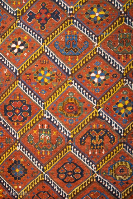 Middle of 19th Century,Central Asia, central Amu Darya valley Beshir ıkat design rug.An antique Beshir showing a diamond design; flowers, palmettes and botehs alternate in the various compartments. –The original kilim finishes  ...