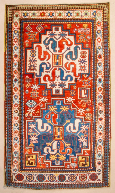 This Middle of 19th Century antique red-ground Chondzoresk is entirely filled by two immaculately drawn medallions in white and light blue, each enclosing the design of a central rectangle and eight snake-like  ...