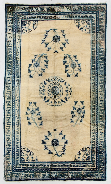A rare and beautiful 18c carpet from East Turkestan or Western China, 6.2 x 10.5 feet (188 x 318 cm). Small areas of old faded repiling, minor losses, localized wear. Your comments  ...