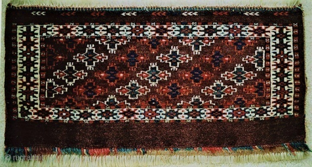 Solid Yomut torba with erre gol pattern, firm dense pile, emerald green, apricot and indigo dyes on a dark purple/brown ground, perfect condition.circa 1900. 1,100 USD checks only, plus US shipping.