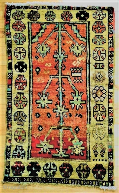 Small format prayer rug from Konya/Capadoccia, circa 1800-25. Very unusual village-woven collector piece. Bold scale archaic Tree of Life beneath the stepped mihrab arch. Small spots of Old reweaves, re-selvaged. 25 x  ...