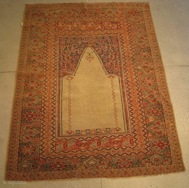 "A mid-19th Century Ghiordes Prayer Rug, 5'5"" x 4'0"".  Great color with traditional pattern.  Reselvedged, flat-stitch repairs, and normal wear associated with rugs from this period."