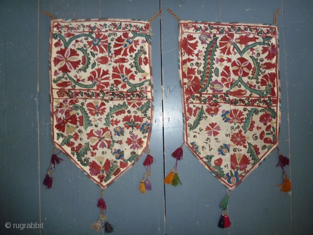 Beautiful antique suzani fragments made into a pair of ok bash like decorations, 58 x 35 cm, 23 x 14 inch