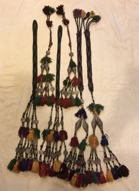 "Kuchi afghan silver tassel olam tassel decorative unique tassel ethnic and tribal tassel  Vintage Kuchi afghan tribal silver tassel  Size :almost more or less Height : 75 cm    VINTAGE UZBEK TASSELS : ""Segusha""( Triangle) is a  ..."
