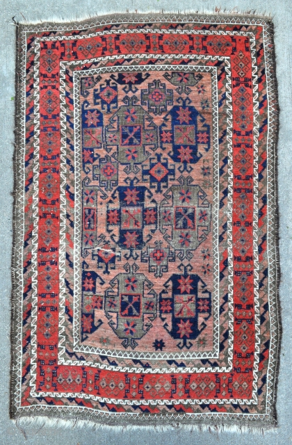 Baluch rug with Gurbaghe Guls and rare border, all natural colors including a nice lavender and purple, 19th c. piece in good original condition without repairs.