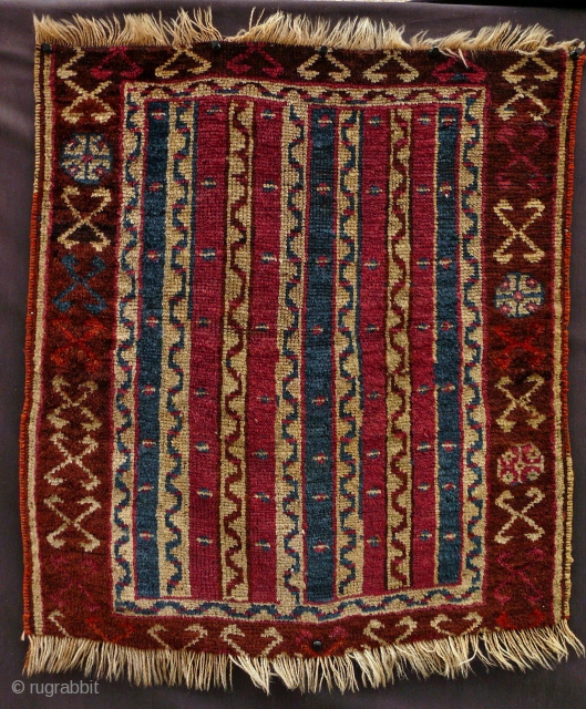Yuruk yastic, E. Anatolia, 61.5 X 67.5 cm. This in in the Bags and Trappings section of our web site: http://gallery-arabesque.com You may find more images and information there.
