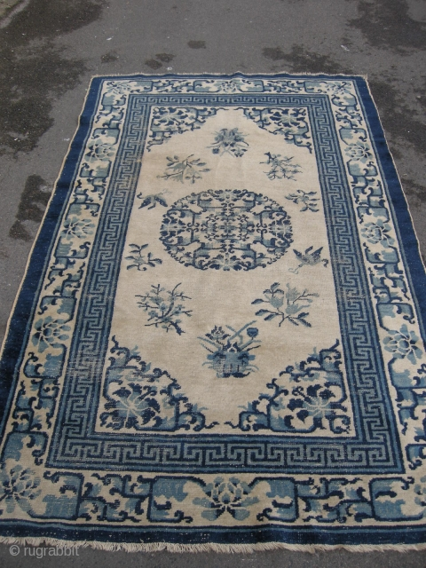 An antique Chinese rug 6ft11 x 4ft1, some wear and a surface stain as shown, nice design and pattern.