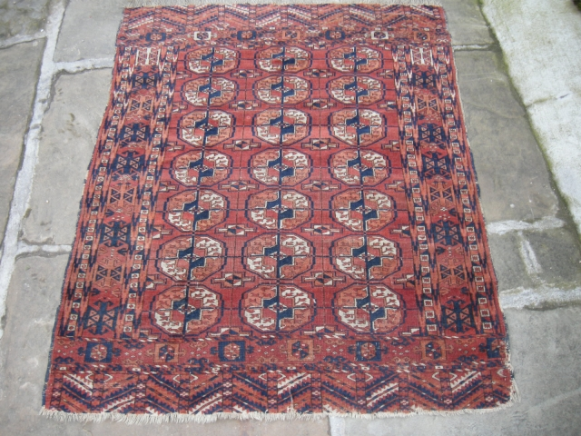 An antique tekke wedding rug, 4ft6 x 3ft6 good colours and interesting design, very slightly worn ,new find will clean well,much nicer than the pics suggest.