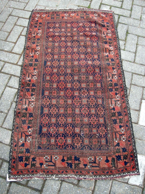 An antique belouch rug nice colours even corrosion and a few other issues as seen but a very pretty antique rug will clean well approx. 4ft9 x 2ft9.