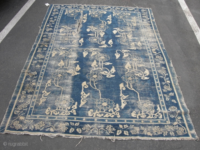 A very unusual beautiful very old Chinese rug worn with hole as seen approx. 7ft x 5ft