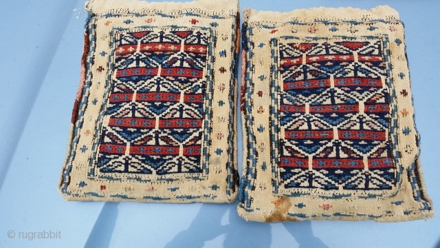 A small pair of Antique Chanteh Bags . Plain white on the back, complete made into miniature cushions.