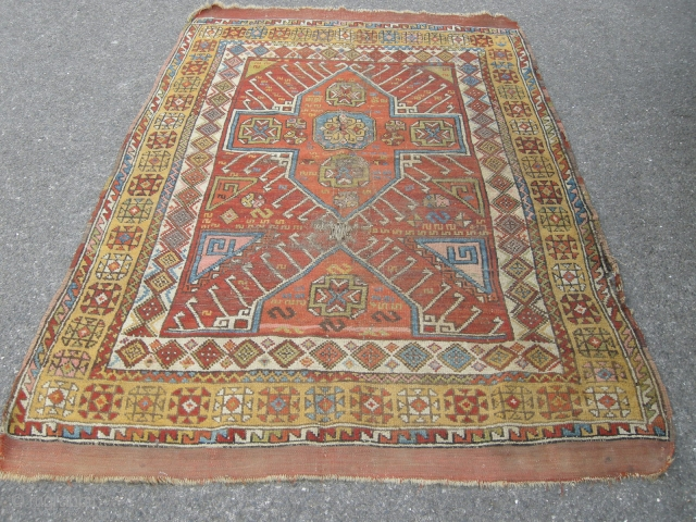 A beautiful Antique Turkish rug approx 6x 4 ft or a little larger. Just bought. Dirty and some wear with some damage but has a very graphic design with good colours ,  ...