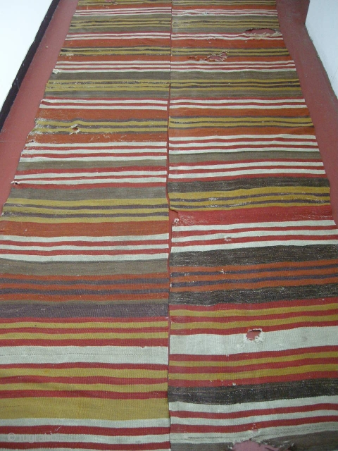 early 19th century Anatolian kilim in two parts. Some holes but repairable. Good early colours. 12ft x 4ft4 .