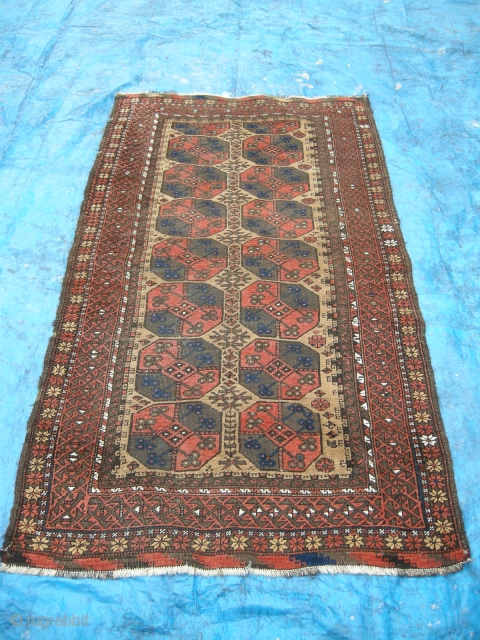 An attractive antique Beluch rug c1900, camel ground with piled ends. Lightly worn with some corrosion, could benefit from a ligth clean. 6ft x 3ft6 approx.