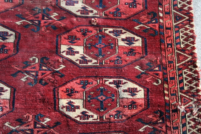 """An early, Kizil Ayak main carpet fragment about 6'4"""" x 4'4"""" with asymmetric open right knotting, good color, early and stylized Dyrnak minor guls, Major guls with the """"Mounted Knight"""" image that  ..."""