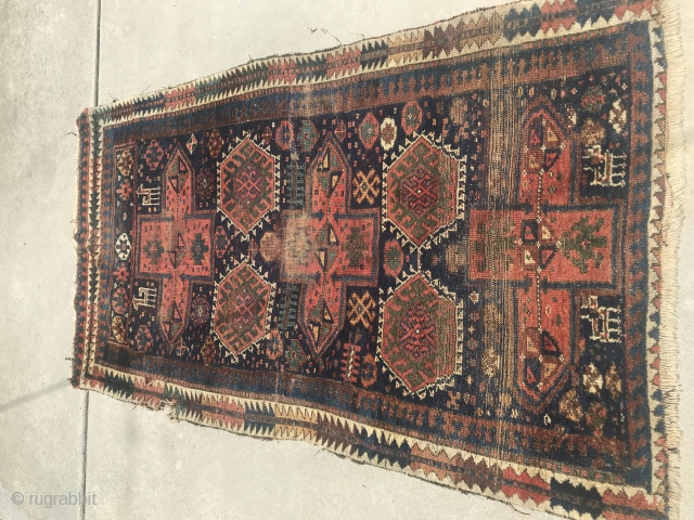 19th Century Kurdish rug with some damaged areas.
