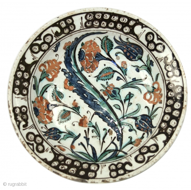 Iznik Plate; Ottoman Empire; Circa 1600; 10'' in diameter;  A detailed article on these magnificent pieces of art can be found here: https://www.christies.com/features/Iznik-Pottery-Collecting-Guide-7183-1.aspx