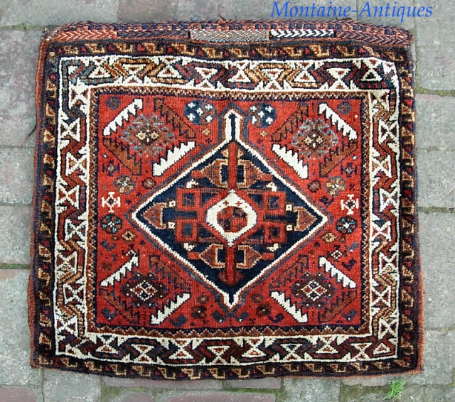 S. Persian-- 24 x 26 inches. I guess Luri or Qashqai. Whatever. This is a really nice quality piece in excellent condition. $20 ups to Lower 48
