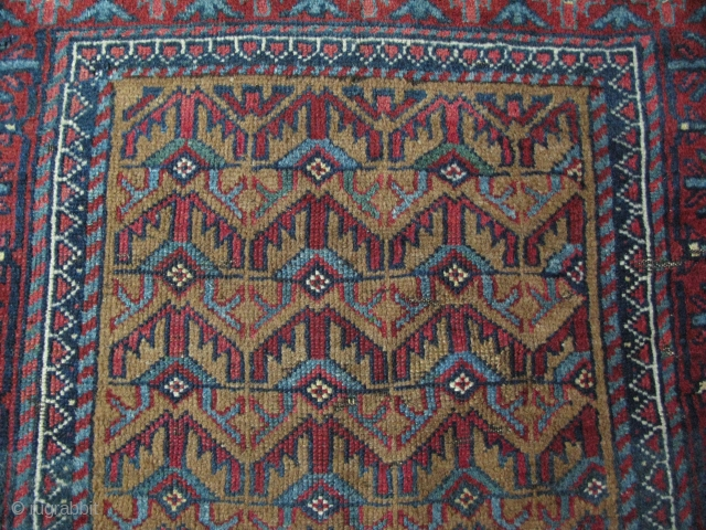 "Baluch rug. Camel hair ground. Circa 1900. Size: 40"" x 59"" - 103 cm x 151 cm."