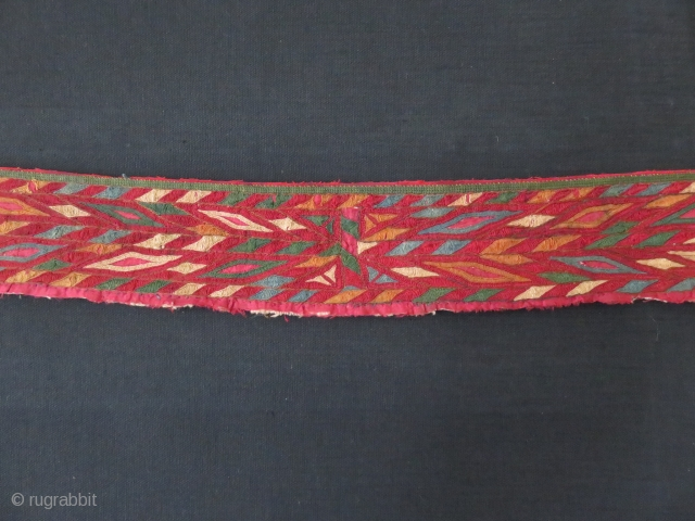 "Turkmen Chirpy collar. Fine silk embroidery on silk. Great saturated natural colors. some wear. Hand woven plain cotton backing.. Circa mid 19th cent. Size: 50"" by 3"""