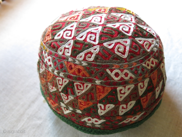 "Turkmen Chodor ceremonial large size silk / some cotton embroidered tribal Hat. Tiny blue embroidery on the side indicates of protection of the owner against ""Evil Eyes"". Plane cotton lining. Circa 1920  ..."