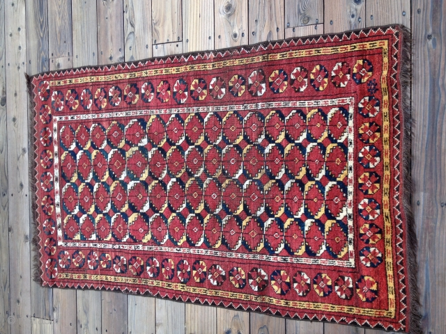 Antique Turkoman Beshir Rug with an uncommon design and natural dyes including an exceptional lemon yellow. Warps are goat hair. Some minor reweaves in the field. Size: 63 X 40in/160 X 109cm.  ...