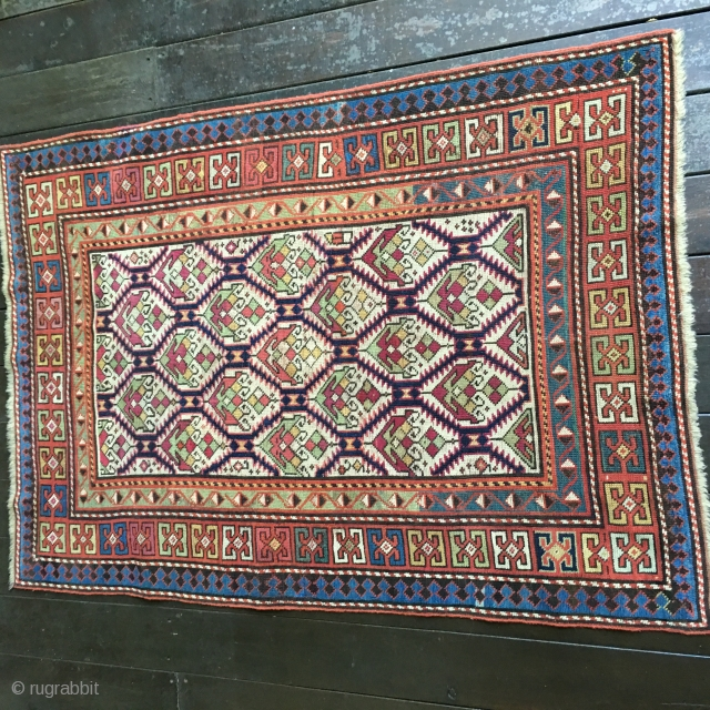 Stunning Antique Caucasian Kuba or Dagestan rug with field lattice design containing colorful palmettes. All natural dye colors including gorgeous light greens, blues and yellow. Very good condition with original ends and  ...