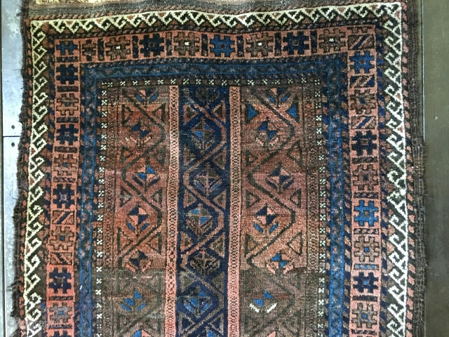 Antique Baluch rug circa late 19thC. Unique palette with field consisting of border designs. All natural colors including a brilliant light blue. Fair condition with areas of wear as well as places  ...