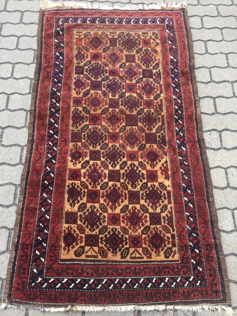 Antique camel ground Baluch rug with beautiful hooked motifs, saturated colors, pepper backside. Size: ca. 170x90cm / 5'9''ft x 3ft