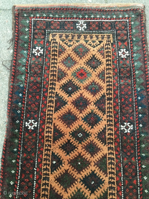 Antique camel ground collector´s Baluch balisht, glossy wool and cool graphics, nice collector´s item. Size: 86x41cm / 2'8''ft x 1'3''ft all natural colors.