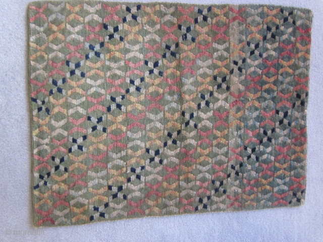 Tibetan mat with unusual,multi-colored twined  design on faded green ground, c.1930, 22 by 29 inches