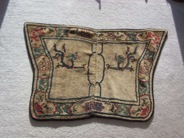 Tibetan butterfly saddle piece with two dragons eagerly (see facial expressions) possessing and pursuing flaming pearls. Sixe:26 by 43 inches. c.1900. Border has Chines-inspired design elements and some peppering of color in  ...